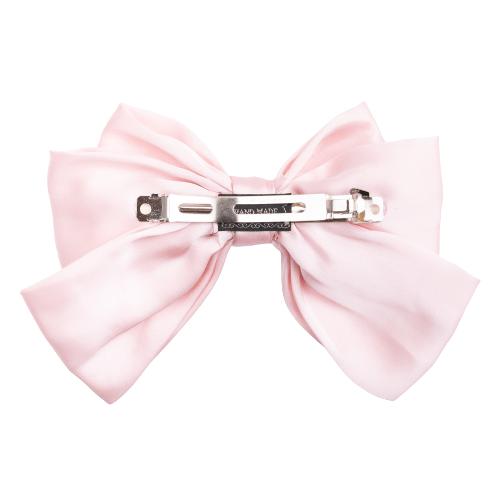 Rosa silke sloejfe bag removebg preview 2 | Kæmpe stor antik rosa sløjfe i satin med stort klik spænde